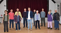 Singing group meets for first time with West End actor