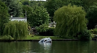 Car rolls into river and sinks after brake fails