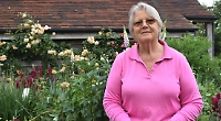 Woman who transformed garden opens it to public in aid of air ambulance