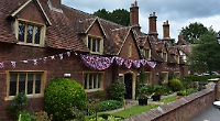 MP revisits almshouses to mark association's 75th year