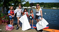 Families volunteer to fish old rubbish out of river