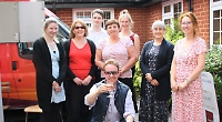 Staff celebrate accountancy firm takeover