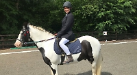 Teenage girls compete in national dressage competition