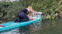 Paddleboarders clear rubbish from Thames on Rivers Day