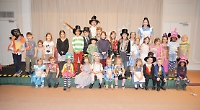 Children dress up for Alice in Wonderland themed party