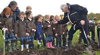 Children's author gives pupils a hand with planting trees