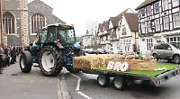 Tractor and trailer lead funeral cortege through town centre