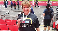 Woman raises £1,250 for charity with first half marathon