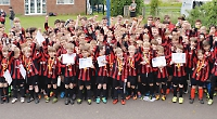 Junior footballers celebrate successful season with public open day