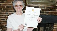 Former teacher awarded honorary degree at age 79