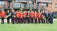 Young musicians perform concert with royal military band
