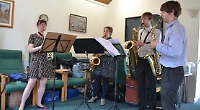 Jazz quartet perform for pensioners at charitable concert