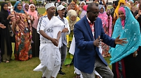 Visiting Somali friends make song and dance on meadows