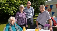 Care home residents enjoy party with families