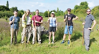 New wildflower meadow cut by hand to encourage growth
