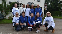 Walkers raise £2,800 in memory of publisher