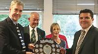 Arlett and Sheddon lift memorial trophy