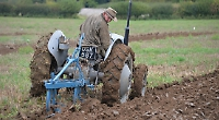 Soft mud is great for ploughing people but not spectators