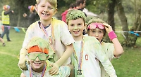 Colour of money... families plastered at school's fund-raising fun run