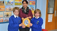 Mother donates defibrillator to village school