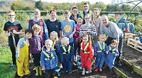 Nursery children learning to lead good life at allotments
