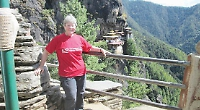 Librarian completes 16th charity trek in Bhutan mountains