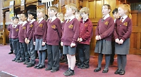 Four into one... primary school choirs perform with professional singing group