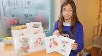 Budding artist sells festive nature cards at village shop