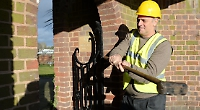 Olympic champion begins demolition of rowing club's entrance gate