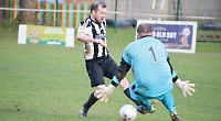 Bullett fires home hat-trick as league leaders march on