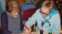 Girls hold bingo night for old folk