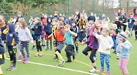 Children thrilled after all-weather pitch is resurfaced