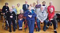Choir festival organisers present £1,500 to stroke club