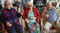 Care home residents reminisce while baking for charity