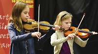 Children learn to perform in public at youth festival's junior proms
