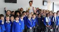 Olympic champion thrills children with museum visit