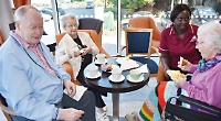 Care home residents enjoy coffee and cake for charity