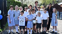 Pupils treat locals to tea party