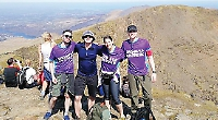 Man who lost bowel to illness climbs Mount Snowdon