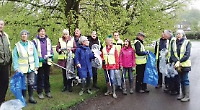 Volunteers clear litter from village streets