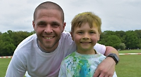 Children and parents get splattered with paint at fund-raising fun run