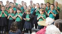 Children sing for old folk