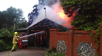 Couple's garage goes up in flames