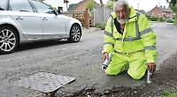 Village pair trained how to officially identify potholes
