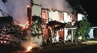 Fire destroys billionaire's home
