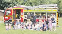 Children cool off thanks to visiting firefighetrs