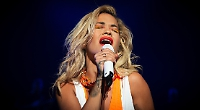 Rita Ora lifts spirits of festival crowd after World Cup defeat