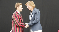 Olympian presents prizes at college