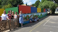 Mother paints 15m river-themed mural at her children's school