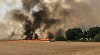 Firefighters battling blaze in Shiplake field